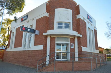 The National Australia Bank's decision to only operate its Condobolin Branch for three days a week has disappointed and outraged the community as well as many of its local customers.
